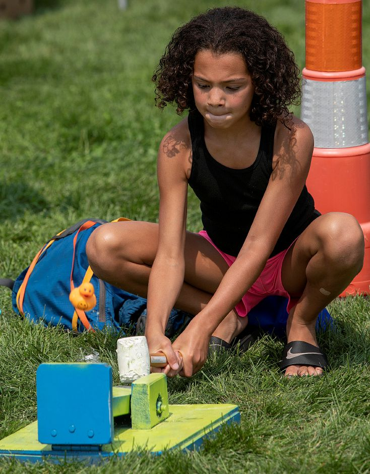 Brianna Cusimano, 10, of Meriden, sends a rubber duck airborne with a hammer during the Community Health Center's health fair on the Meriden Green, Thursday, August 16, 2018. Community Health Center, Inc. is celebrating National Health Center week with a series of fairs around the state, including Meriden's event. Dave Zajac, Record-Journal