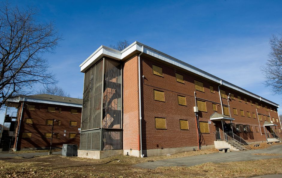Former Mills Memorial apartments boarded up on Mill Street in Meriden, Monday, January 16, 2017. | Dave Zajac, Record-Journal