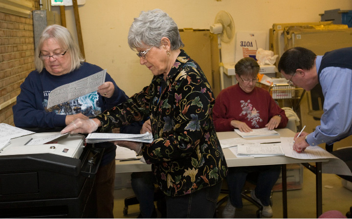 FILE PHOTO -- Maureen Flynn, Democratic Registrar, left, and Toni Soboleski, Republican Registrar, insert ballots into a voting machine during a recount for City Council Area 2 at the Rushford Center on Paddock Avenue, Tuesday, November 10, 2015. Joseph Carabetta III remained the winner over longtime councilor Matthew C. Dominello after the recount.  |  Dave Zajac / Record-Journal