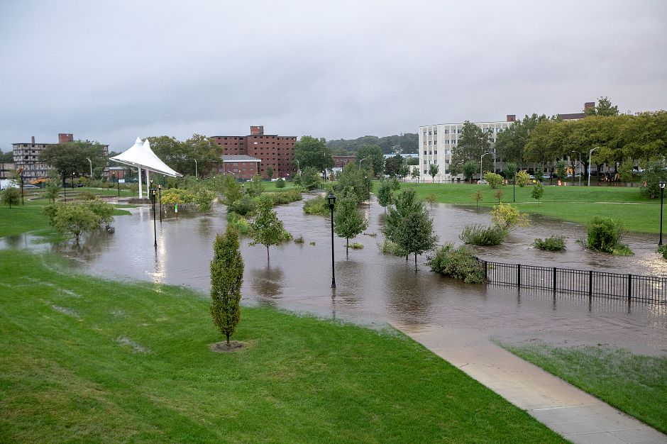 Harbor Brook overflows its banks on the Meriden Green in Meriden, Tuesday, Sept. 25, 2018. Heavy rain Tuesday evening closed roads and flooded basements of local homes. Dave Zajac, Record-Journal