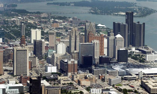 This July 16, 2013, aerial file photo, shows downtown Detroit. In its pitch to convince Amazon to locate its second headquarters downtown, Detroit has offered something once considered an embarrassment: vacant space. The proposal to the Seattle-based online retail giant includes office space in existing buildings, more square footage in projects under development and nearly 100 acres to build on. It also features a promise from utilities to offer wind power and systems to maximize energy efficiency, and partnerships with universities. (AP Photo/Paul Sancya, File)