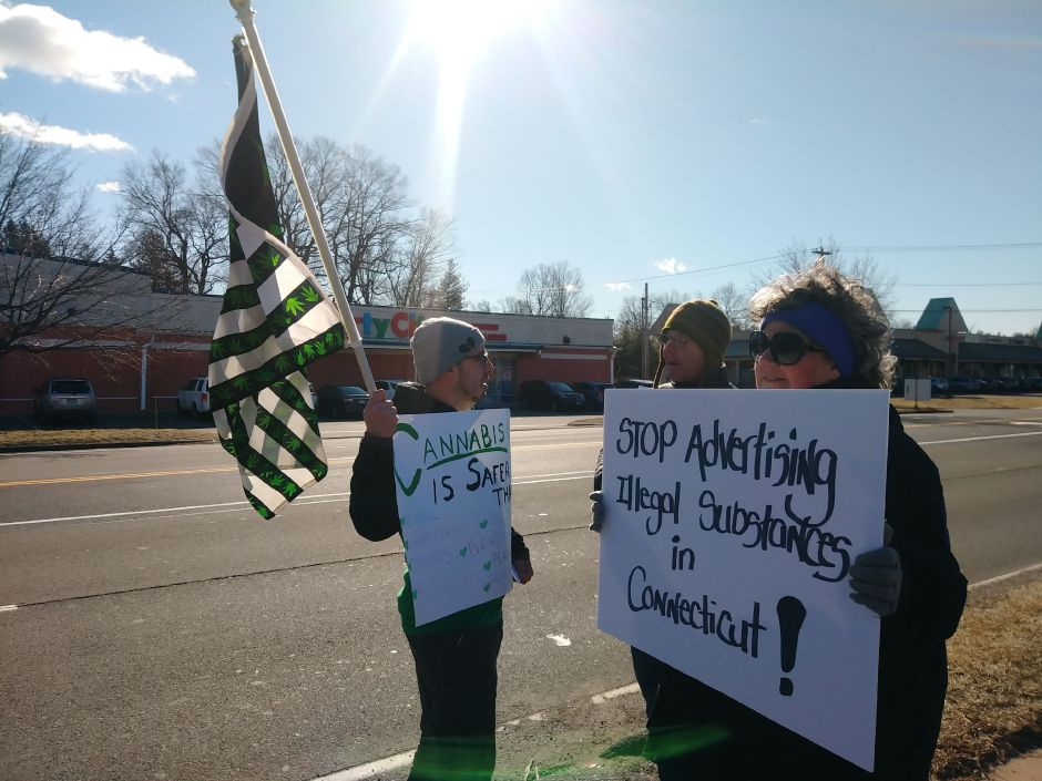 Cody Roberts, of Seymour, stands opposed to David Ott and Robin Cotter, of Wallingford, protesting on Washington Avenue against a billboard advertising the sale of marijuana in another state. in North Haven, Sat. Feb. 9, 2019. Jeniece Roman, Record-Journal
