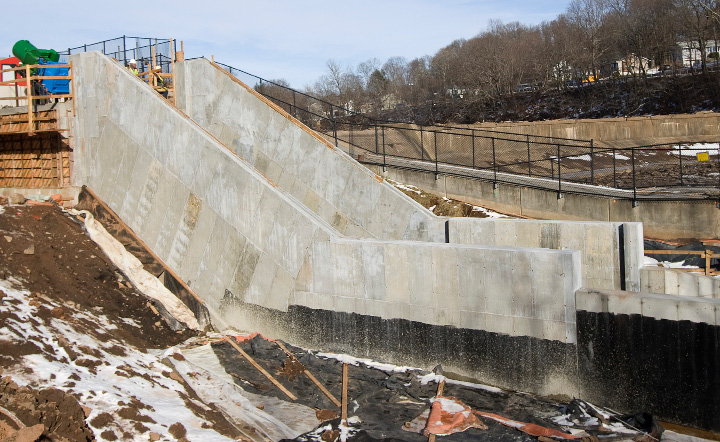 Workers prepare for installation of an Archimedes screw at Hanover Dam in Meriden, Monday, December 19, 2016. The project, the first of its kind in the state, utilizes technology attributed to the ancient Greek scientist Archimedes and is expected to save the city $20,000 a year in power costs and property taxes.  | Dave Zajac, Record-Journal