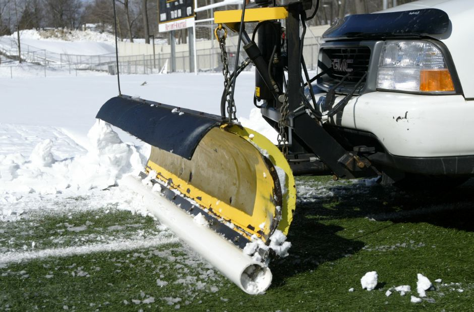 Rob Zebora, Meriden Parks & Recreation worker, plows the snow off of Falcon Field on Thursday, February 18, 2010. The front snow plow blade was modified with PVC tubing covering the blade so it won