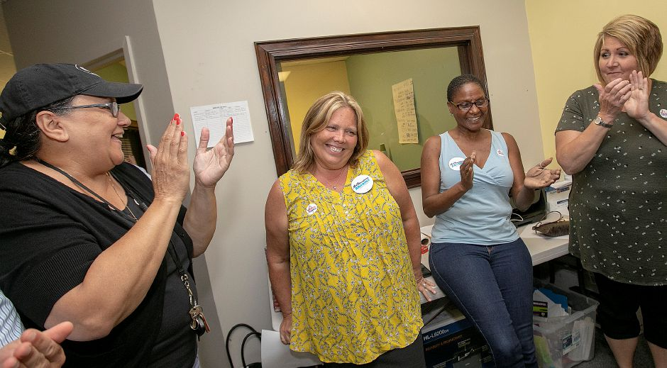 Mary Daugherty Abrams is applauded after winning the Democratic primary for the 13th Senate seat Tuesday night in Meriden, Aug. 14, 2018. Left to right are, state Rep. Hilda Santiago, Mary Daugherty Abrams, City Councilor Sonya Jelks and Board of Education member, Pam Bahre. | Dave Zajac, Record-Journal