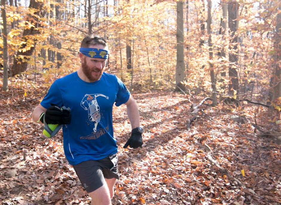 Jay Mitchell runs through the trails around the Southington YMCA's Camp Sloper during the Connecticut Trailmixers' Fall Fling 400 on Sunday.