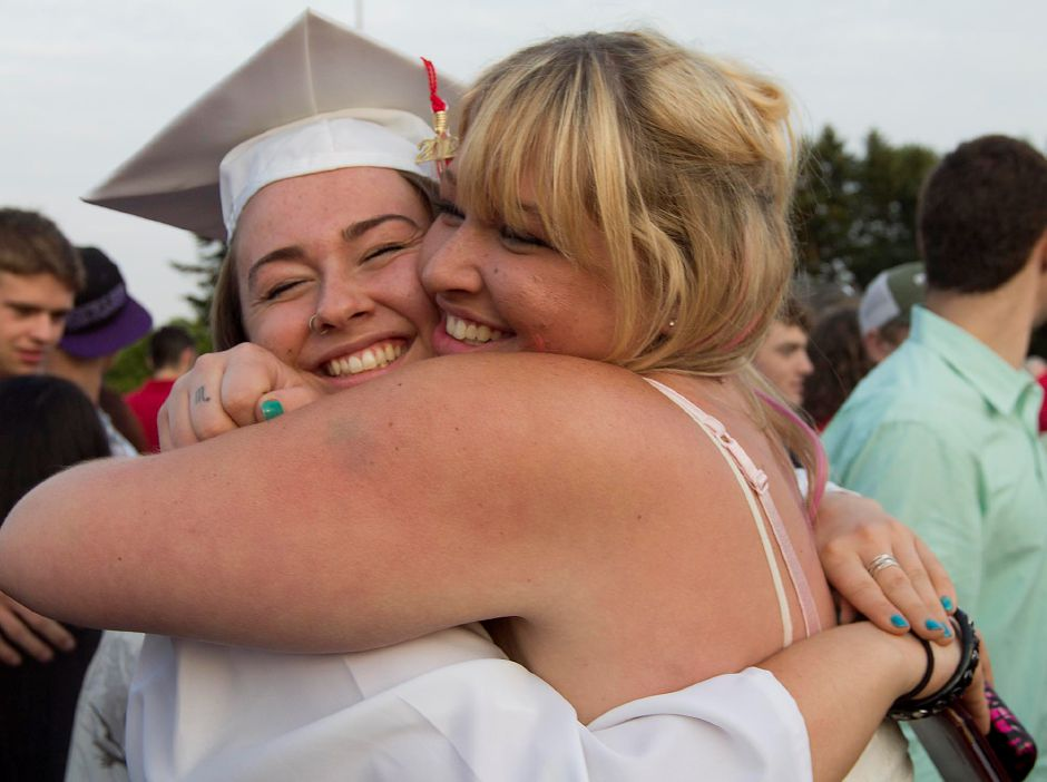 Cheshire High School graduate Amanda Shalagan gets greeted from friend Lara Zychowski after graduating on Tuesday June 19 2012. (Savannah Mul/Record-Journal)