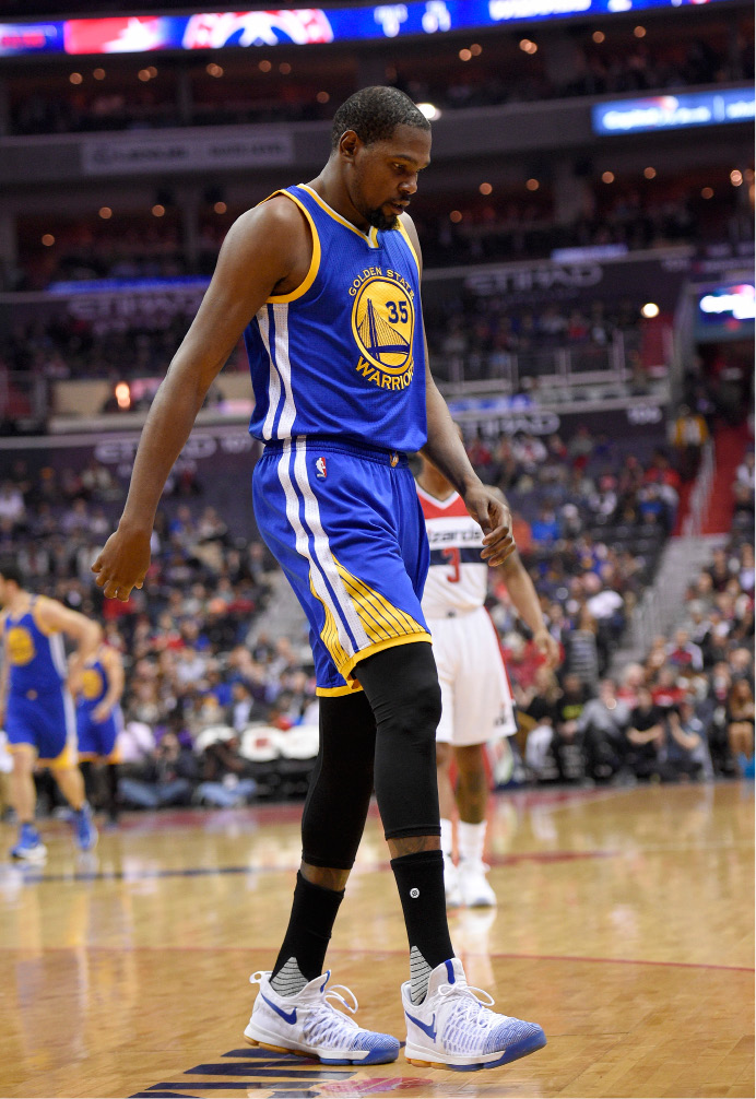 Golden State Warriors forward Kevin Durant (35) walks to the bench during the first half of an NBA basketball game against the Washington Wizards, Tuesday, Feb. 28, 2017, in Washington. (AP Photo/Nick Wass)