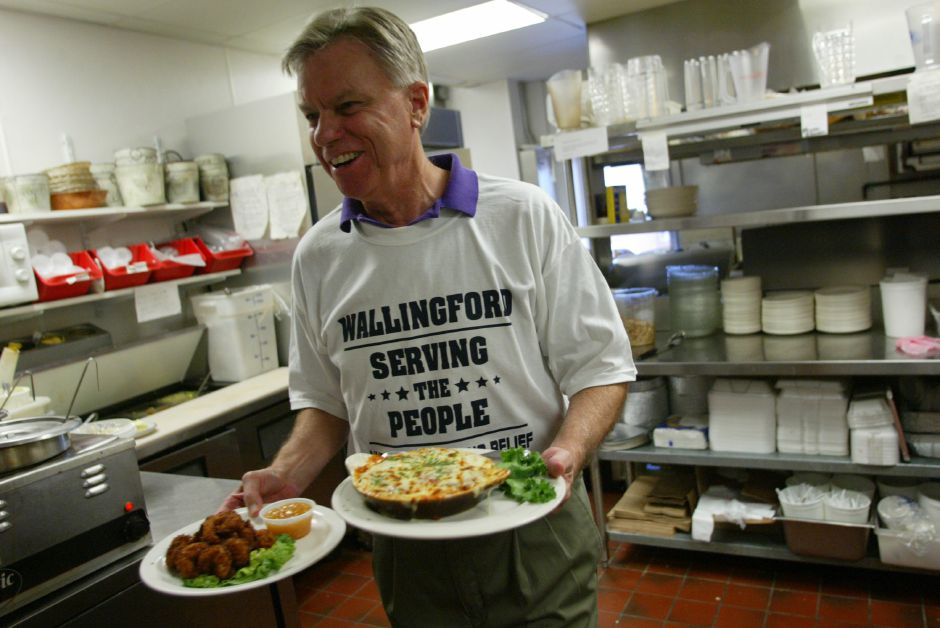 FILE PHOTO – Wallingford Town Councilor Stephen Knight picks up an order in the kitchen while waiting tables to help raise funds for the American Red Cross at Gaetano