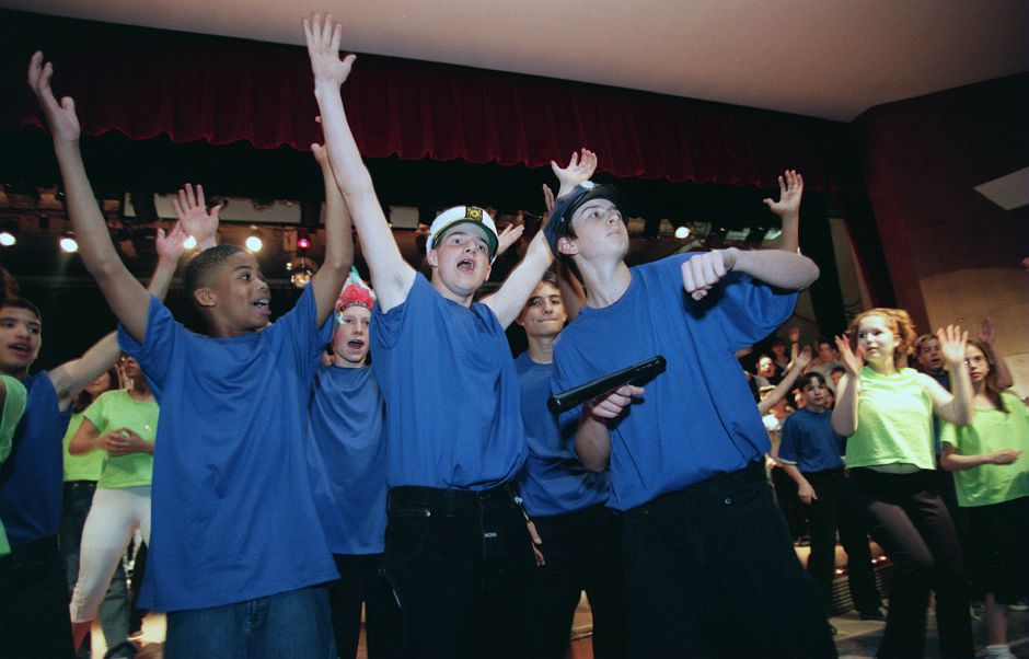 "RJ file photo - Gervais Barger, left, Jason Morytko, center, and Randy Hendricks, right, all eighth-graders at Lincoln Middle School in Meriden, along with about 100 other middle-schoolers, rehearse the song ""YMCA"" for an upcoming musical production, May 1999."