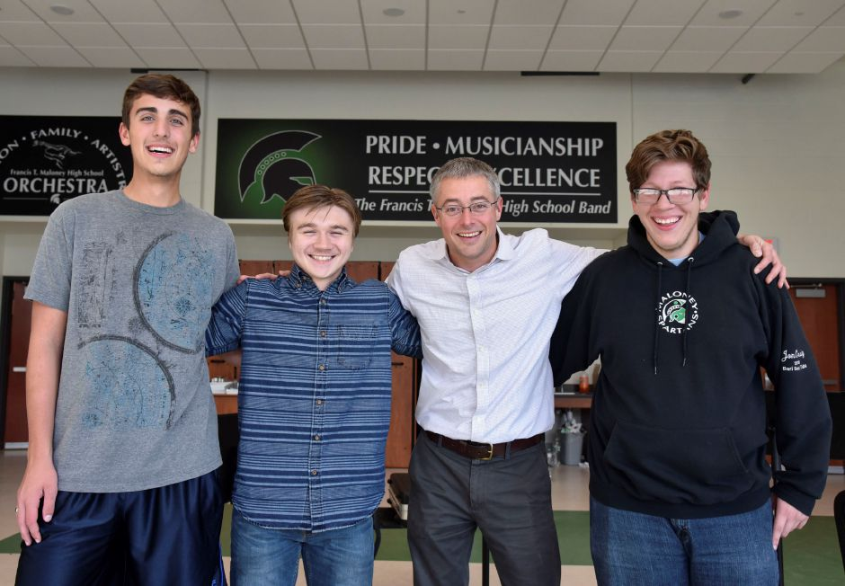 Francis T. Maloney marching band director, Brian Cyr, poses with band members Erik Masoccl, Weston Pytel and Jon Craig at the high school on Oct. 9. | Bailey Wright, Record-Journal