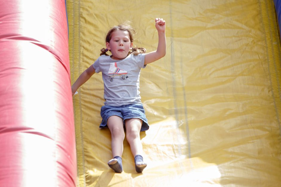 Cara Puhalla 5 of Cheshire takes a turn on the giant slide in the kids area Saturday during the 81st Annual Cheshire Strawberry Festival and Craft Fair on the Town Green in Cheshire May 31, 2016 | Justin Weekes / Special to the Record-Journal