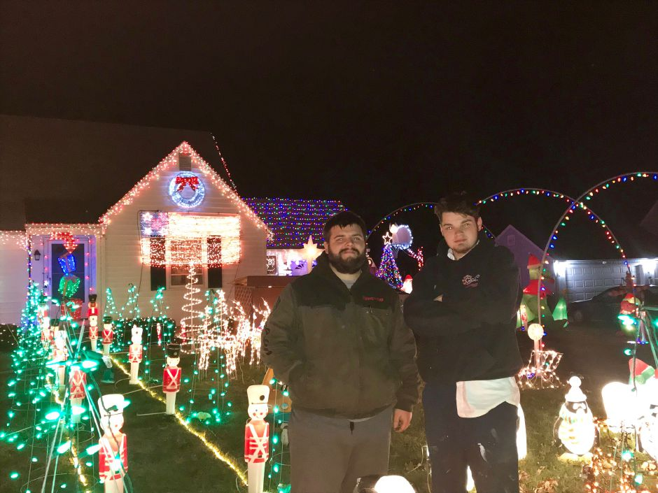 Pictured: Edward Sedgwick-Cochran and Joshua Brunelle.Brunelle's 5th annual Christmas display turns on the lights for the season Dec. 2, in honor of late mother. |Ashley Kus, The Citizen