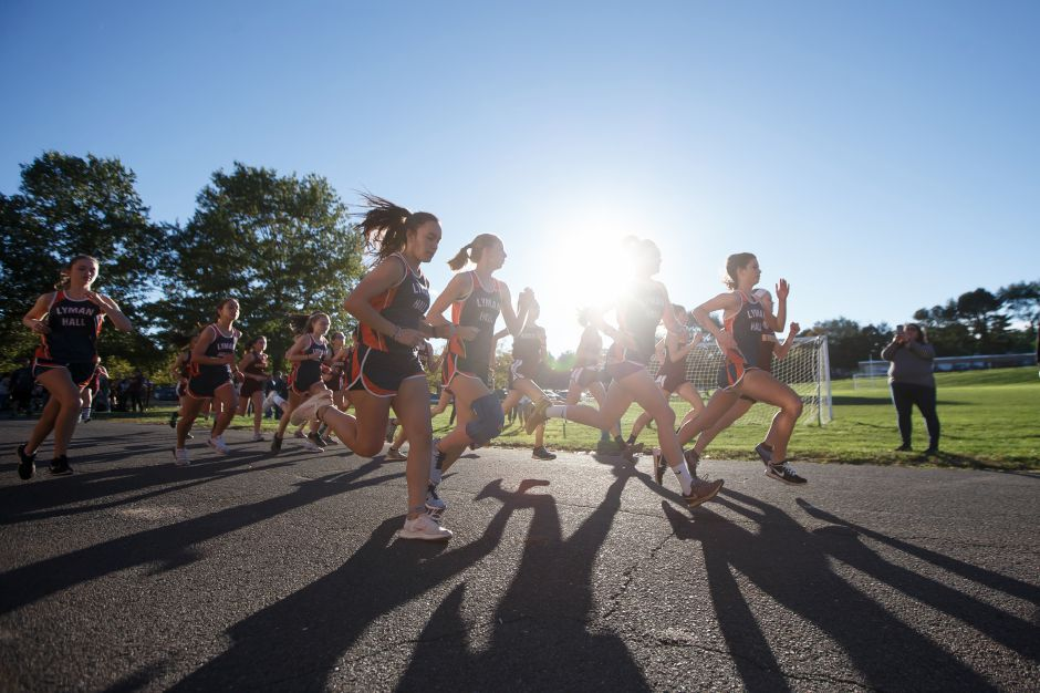 Runners in the girls race leave the start line Friday at Sheehan High School in Wallingford October 12, 2018 | Justin Weekes / Special to the Record-Journal
