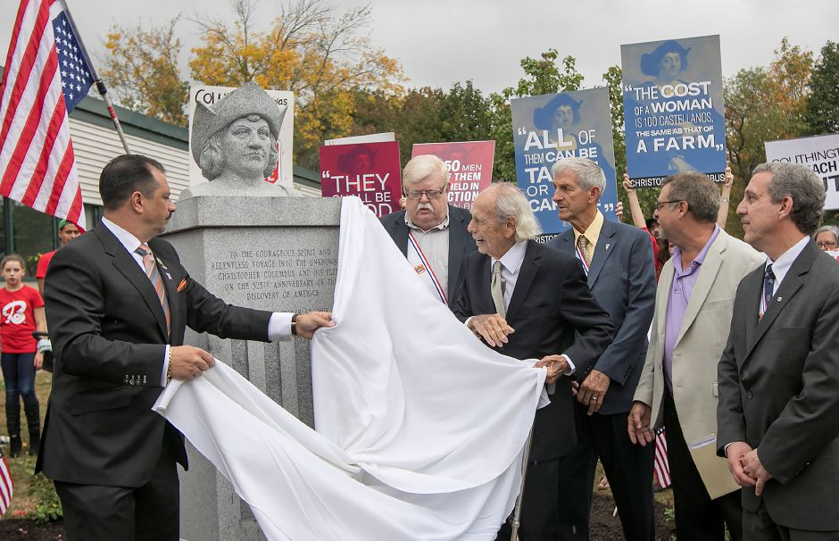 Antonio Cusano, president of the Sons of Italy and past president of UNICO, left, and Dick Fortunato, coordinator of the monument committee, unveil a Christopher Columbus monument during a dedication ceremony at Southington
