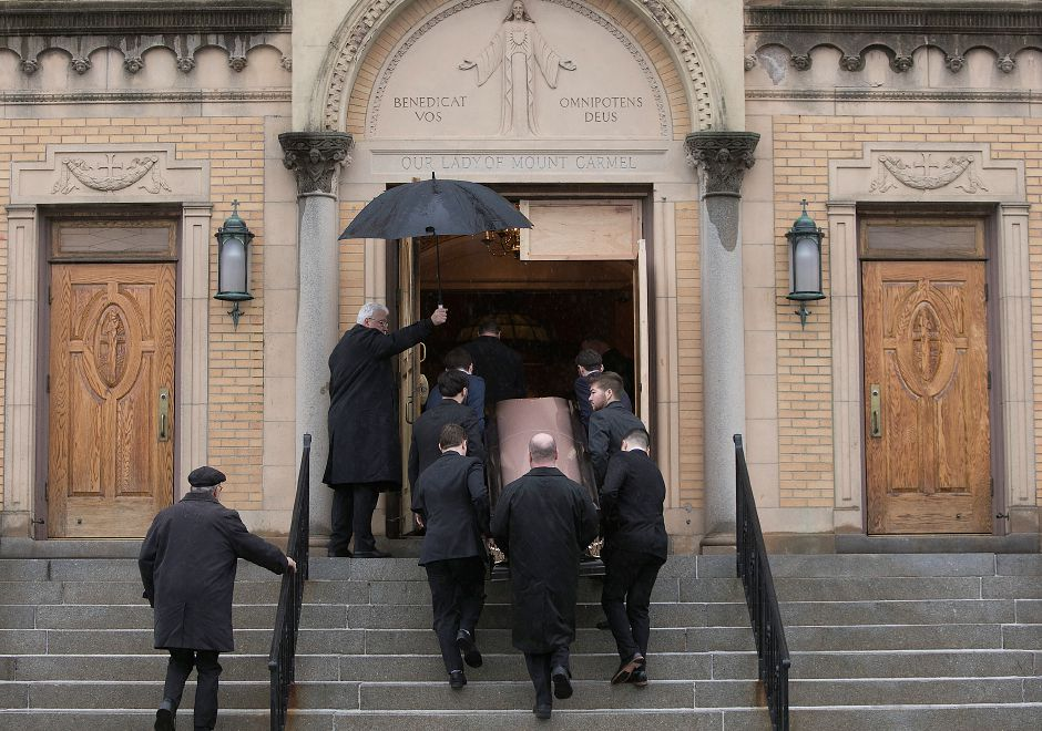 Family members and funeral service personnel carry the remains of Walter Alexander Evilia into Our Lady Queen of Angels Church in Meriden, Tuesday morning, Jan. 23, 2018. Evilia was a former Meriden mayor, co-owner of the Cabin restaurant and owner of Sans Souci restaurant. Dave Zajac, Record-Journal