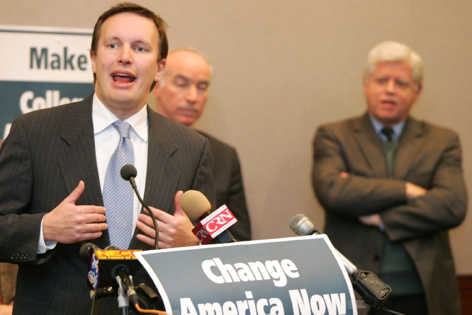 Congressman-Elect Chris Murphy speaks about the agenda of their first 100 hours of the 110th Congress during a press conference at the Legislative Office Building in Hartford Wednesday afternoon December 20, 2006. Behind him are Congressman-Elect Joe Courtney, left, and Congressman John Larsen, right. Chris Angileri/Record-Journal.