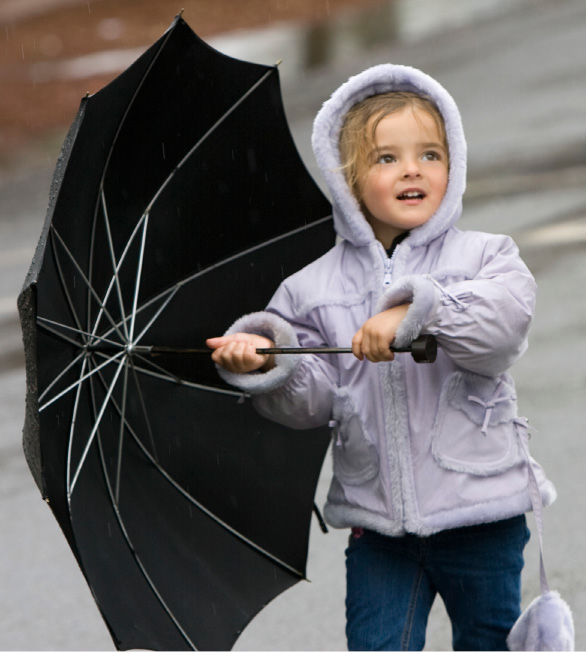 Aubrie Noonan, 3, of Cheshire keeps her umbrella at the ready as showers loom over the 32nd Daffodil Festival in Meriden
