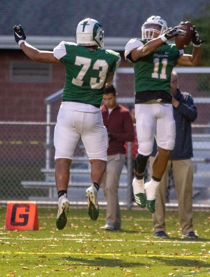 Ethan Hicks (73), Kamron Moreno (11) and the Maloney Spartans improved to 5-0 with Friday's 51-27 CCC Division II-West victory over Bristol Eastern at Falcon Field. Moreno had four touchdown catches from QB Angel Arce. | Aaron Flaum, Record-Journal