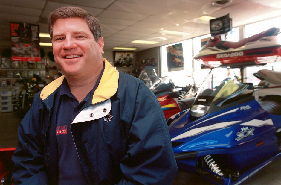 RJ file photo - Mark Fontanella of Meriden is the owner of Connecticut Power and Sport in Wallingford, March 1999. The relatively snowless winter has hurt sales of snow-related products such as snowmobiles and snowblowers, he says.