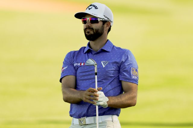 Adam Hadwin, of Canada, watches his shot from the fairway on the 18th hole during the third round of the Desert Classic golf tournament on the Nicklaus Tournament Course on Saturday, Jan. 19, 2019, in La Quinta, Calif. (AP Photo/Chris Carlson)