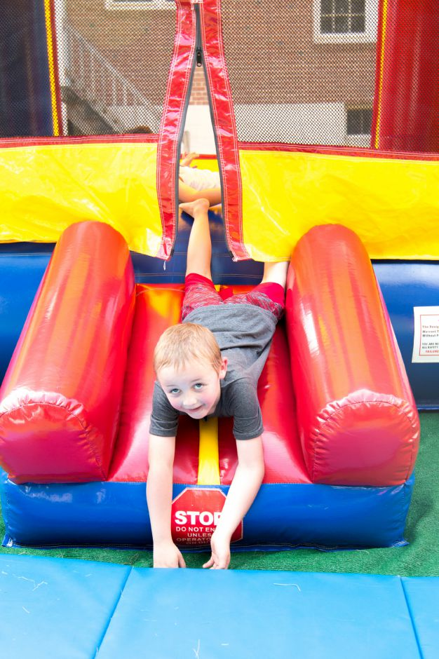 A boy plays on the bounce house at Kensington Congregational Church's Festival on the Hill on June 10, 2017. | Devin Leith-Yessian/Record-Journal