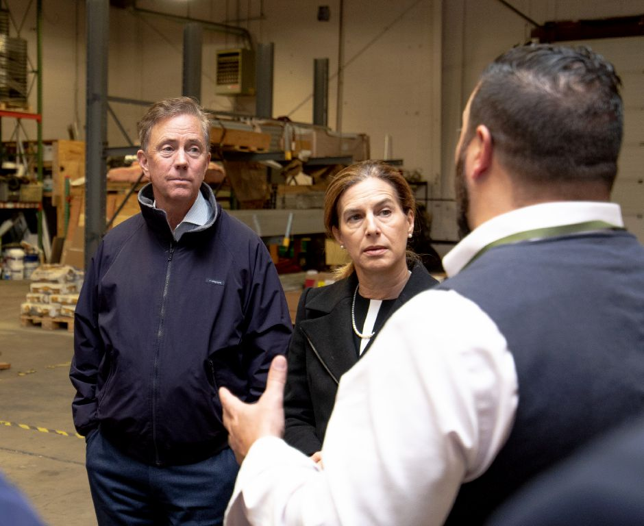 Democratic Gubernatorial candidate Ned Lamont and Lt. Gov. candidate Susan Bysiewicz speak with Jason Celozzi, regional manager of Trinity Solar in Cheshire. Joined by Democratic Senator Chris Murphy, they toured the company and spoke about the importance of clean energy on Oct. 25, 2018. | Devin Leith-Yessian/Record-Journal