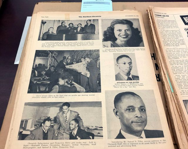 This Nov. 29, 2018, photo shows a Nov. 23, 1946, page highlighting some of the staff of the Hartford Chronicle, a black-owned and operated weekly newspaper in Hartford, Conn. Microfilm from this and other incarnations of the Hartford Chronicle are being digitized as part of the United States Newspaper Program, a collaboration of the National Endowment for the Humanities, the Library of Congress and the states. (AP Photo/Susan Haigh)