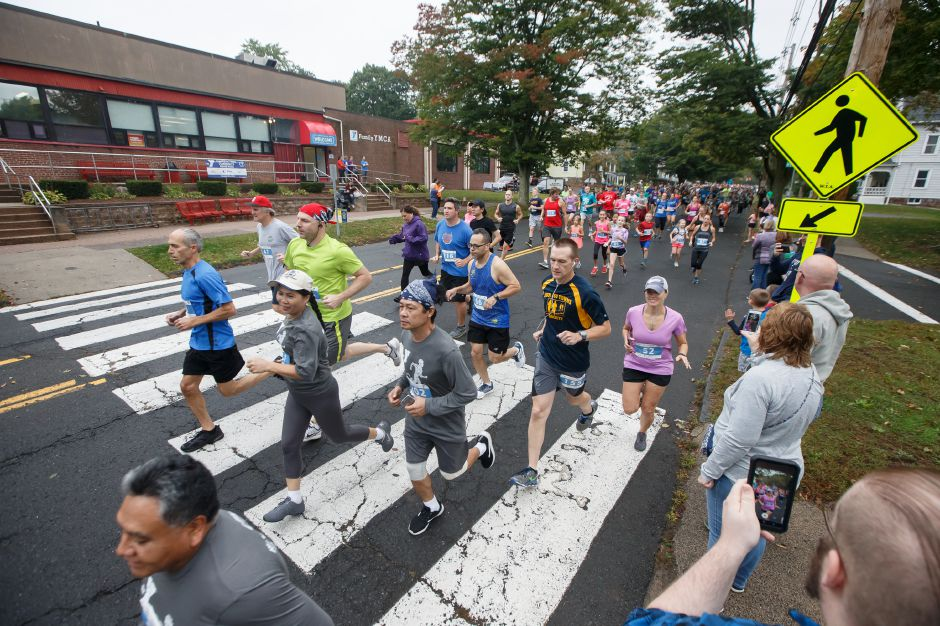 Runners make their way to the start Sunday for the Fishbein/YMCA Community Road Race in Wallingford. | Justin Weekes / Special to the Record-Journal