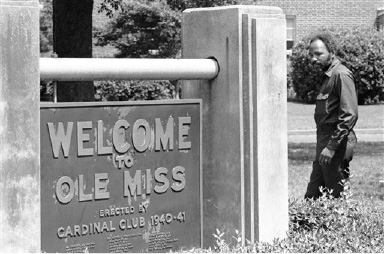 James Meredith passes the welcome sign as he visits the Ole Miss campus unnoticed in Oxford, Miss., Sept. 1, 1972. (AP Photo/Jack Thornell)