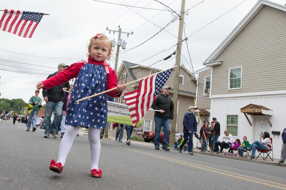 Teagan McGarrah 2 of Southington joins the march Monday during the Southington Memorial Day Parade in Southington May. 29, 2017 | Justin Weekes / For the Record-Journal