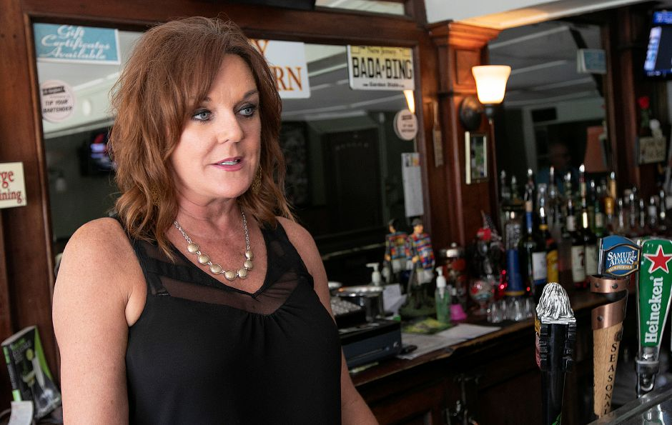 Cindy Cox, owner of City Tavern, talks about the business at 521 Broad St., Meriden, on Monday. She said the bar is closing later this month.