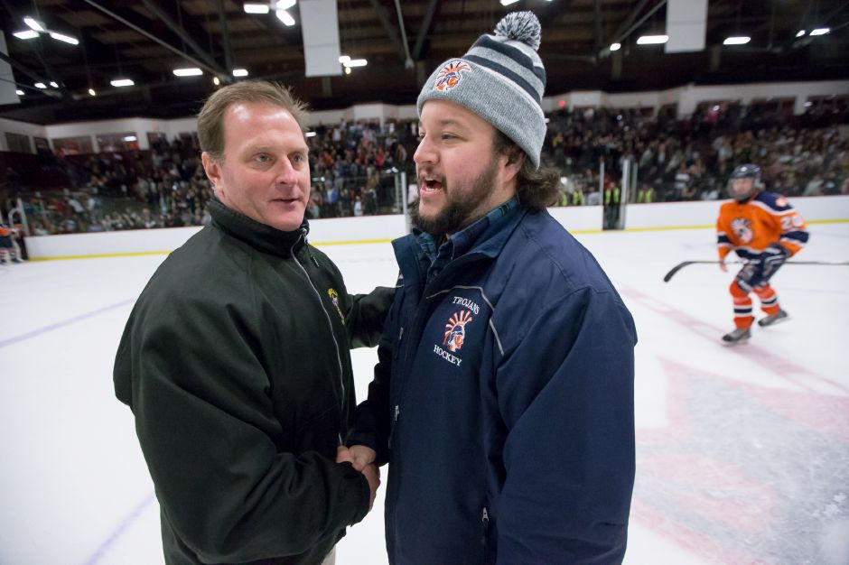 Sheehan coach Dave Festa, left, and Lyman Hall Co-op coach Rich Minnix both saw their hockey teams open 2019 with convincing home wins on Wednesday night. | Justin Weekes / Special to the Record-Journal