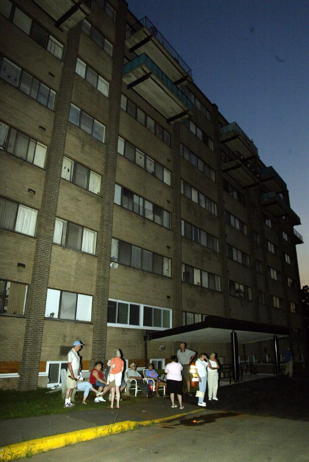 Victoria Towers in Meriden in the dark with some of the residents outside Thurs. night, Aug. 14 during the blackout.