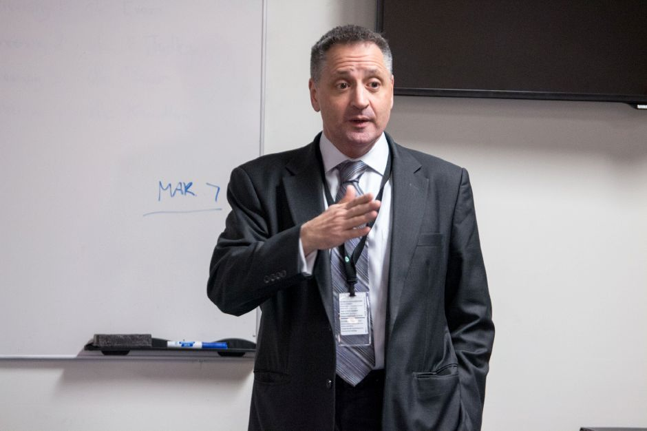 Wallingford Superintendent of Schools Salvatore Menzo addresses parents at a meeting regarding an inappropriate message left on a Sheehan High School whiteboard. The meeting was held at the police department headquarters on Feb. 23, 2018. | Devin Leith-Yessian/Record-Journal