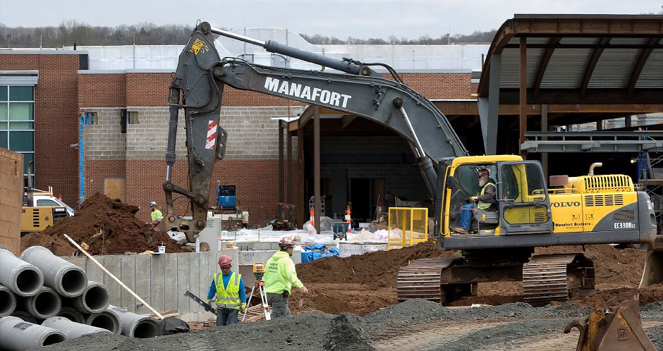 Workers continue construction on the front of Maloney High School in Meriden, Friday, April 29, 2016. | Dave Zajac / Record-Journal