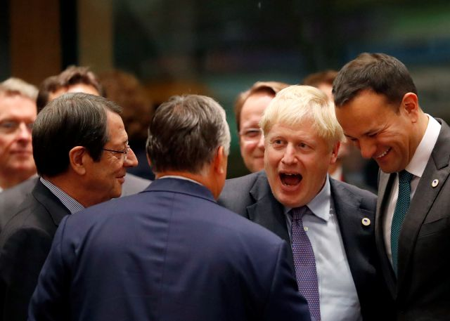 British Prime Minister Boris Johnson, second right, speaks with Irish Prime Minister Leo Varadkar, right, and Hungarian Prime Minister Viktor Orban, center, during a round table meeting at an EU summit in Brussels, Thursday, Oct. 17, 2019. Britain and the European Union reached a new tentative Brexit deal on Thursday, hoping to finally escape the acrimony, divisions and frustration of their three-year divorce battle. (AP Photo/Frank Augstein)