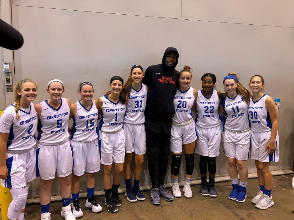 94b2f5b37ac Two-time defending NBA champ Kevin Durant poses with the Connecticut  Starters on Thursday in