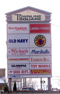 The sign for Townline Square in Meriden is filling up with new businesses after much of the stores area were not occupied.