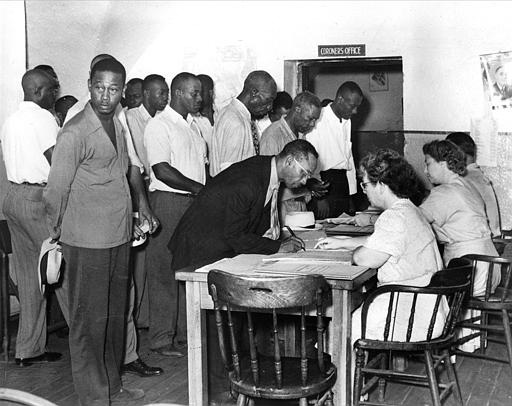Black Americans register to vote as South Carolina Democrats in Charleston, S.C., July 17, 1948.  Blacks in Southern Carolina registered throughout the state after a federal court order was issued forcing the South Carolina Democratic Party to enroll blacks and grant them full participation in party affairs.  In 1944, the U.S. Supreme Court ruled that blacks cannot be denied the right to vote in primary elections.  (AP Photo)