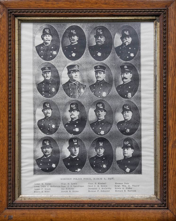 A 113-year-old framed photograph of Meriden police department members donated to the Meriden Police Department by Sheri DeLuca, Wed., July 24, 2019. The Meriden Historical Society coordinated the donation of the photograph during a ceremony held at the police station on Wednesday. The photograph was found in the belongings of Dan DeLuca, a former teacher and local historian, by his daughter after he died three years ago. Dave Zajac, Record-Journal