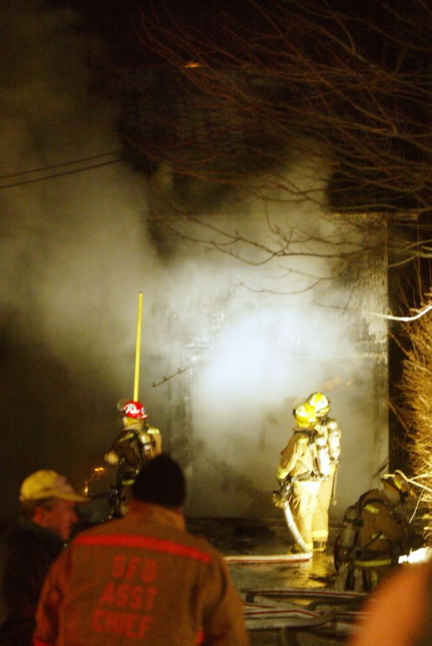 Some flame is just visable on the roof of this barn off Vermont Ave, in Southington Tues. night, Jan. 13 after a fire.