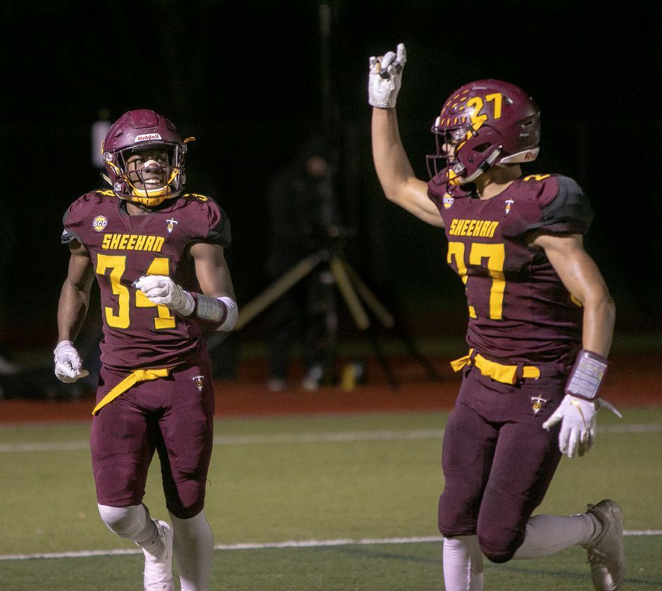 Sheehan junior running back Terrence Bogan, left, celebrates a touchdown during Tuesday night's 43-20 Class M quarterfinal victory over Wolcott with teammate Jordan Davis. Bogan is the area leader and among state leaders with his 2,335 rushing yards and 33 touchdowns on the season. | Dave Zajac, Record-Journal