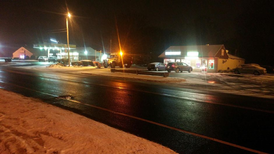 A pregnant woman was taken to the hospital after she was struck by a vehicle on Route 150 Friday, Dec. 15, 2017. | Devin Leith-Yessian, Record-Journal