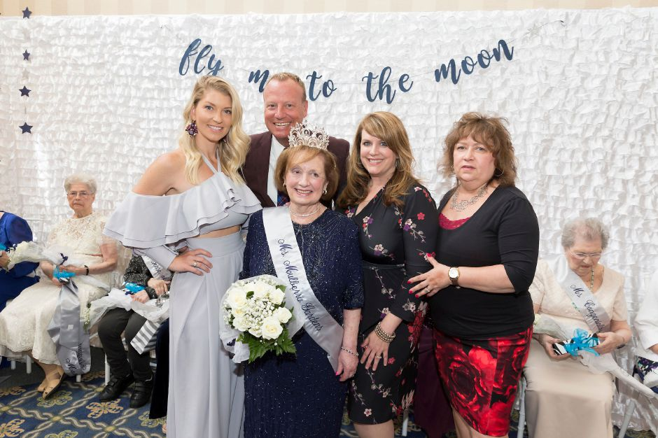 Gathering around Carole Milano, Ms. Senior Mulberry Gardens 2019, are, back row: Judge Kimberly Beaudoin, Emcee Scot Haney, and Judges, Renee DiNino and Kathy Faber.