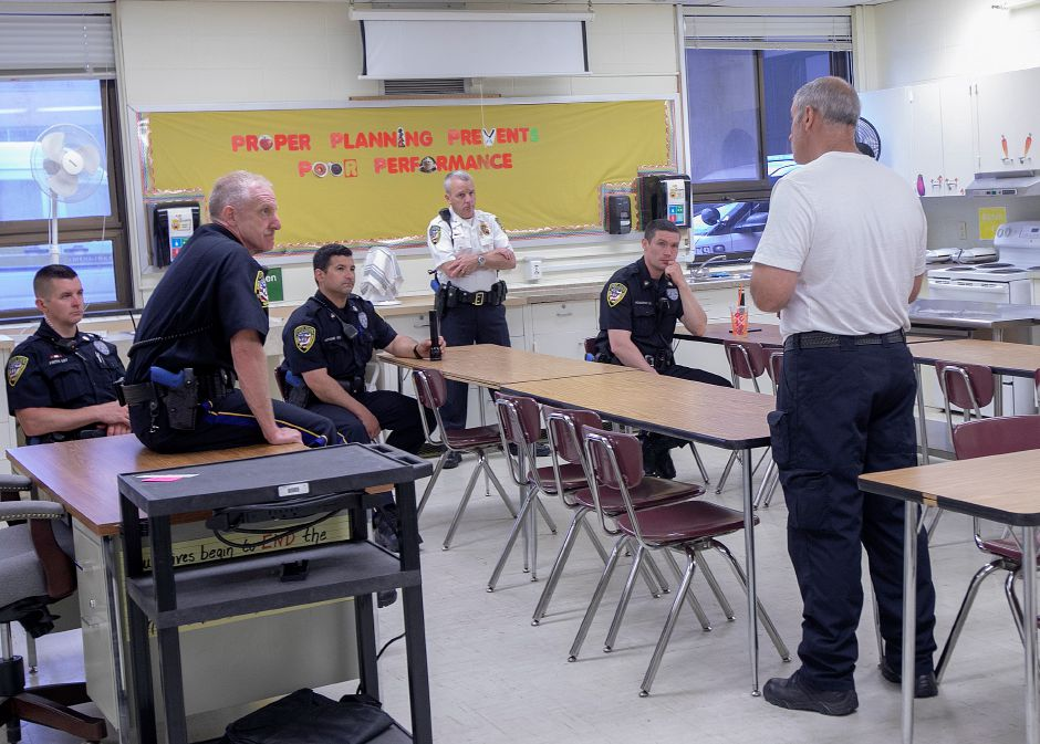 Sgt. Joe Cafasso, right, instructs in a classroom during an active shooter training exercise at Sheehan High School, Tues., June 18, 2019. Dave Zajac, Record-Journal