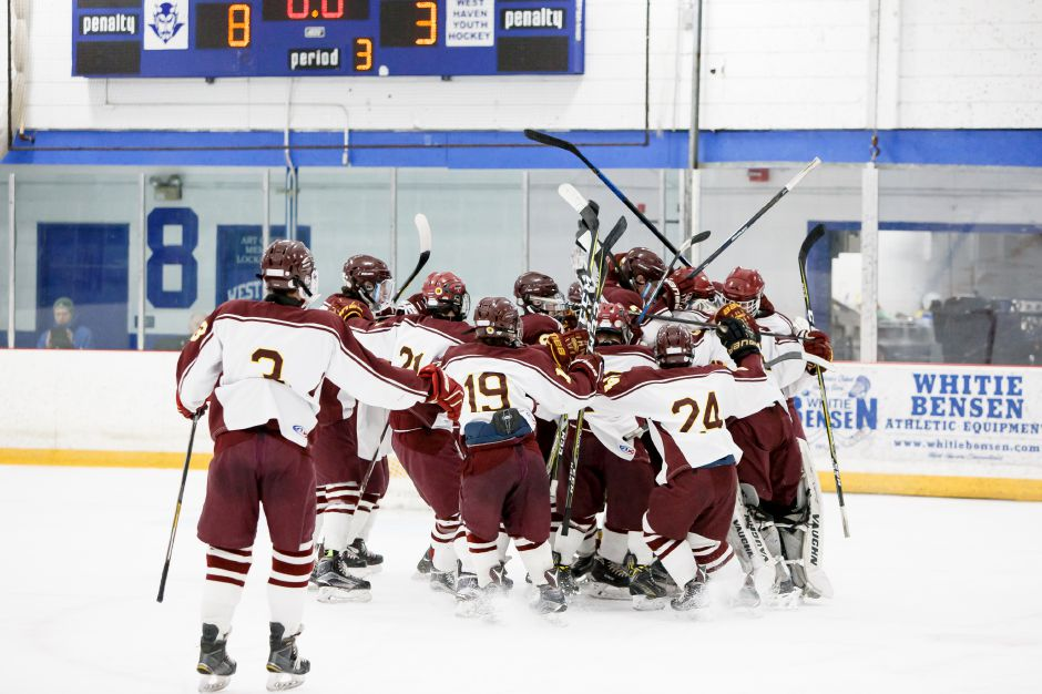 Sheehan celebrates around goalie Tyler Robertson after defeating BBD 8-3 in the SCC/SWC Division III championship game at Bennett Rink in West Haven on Saturday. Justin Weekes , Special to the Record-Journal