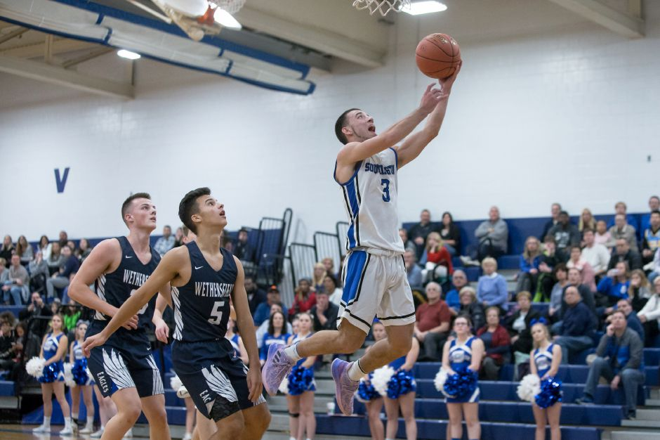 Colin Burdette had a team-high 15 points for Southington in its 73-64 victory in West Hartford over Conard on Wednesday night. It was the eighth straight win for the 12-6 Blue Knights. | Justin Weekes / Special to the Record-Journal