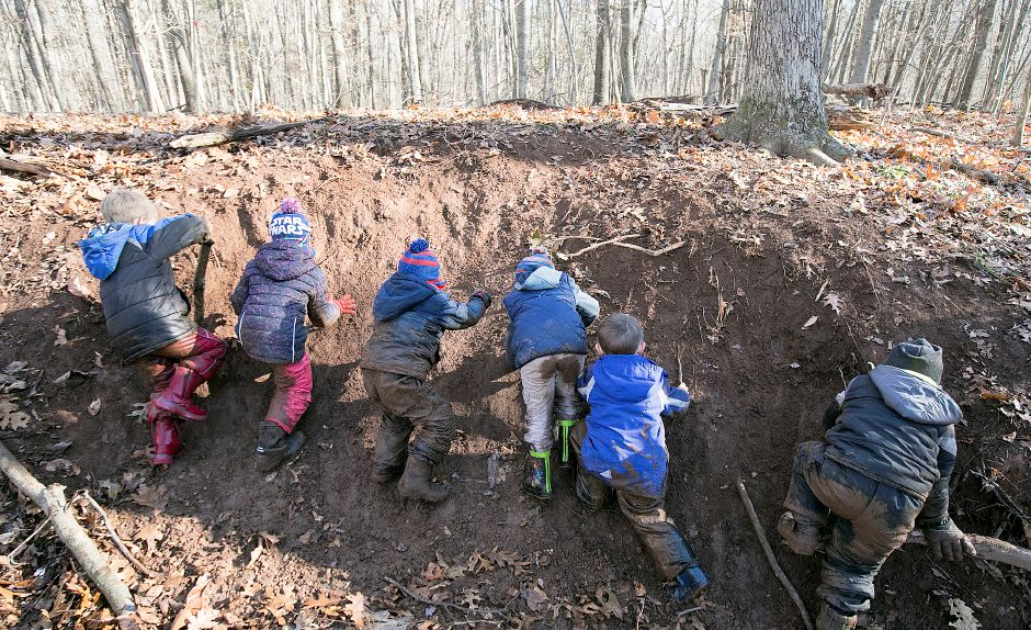 Kindergarteners from Moses Y. Beach Elementary School try their best to climb a slippery hill during the Kinderwoods program at Kohler Environmental Center in Wallingford, Thursday, Dec. 7, 2017. Dave Zajac, Record-Journal