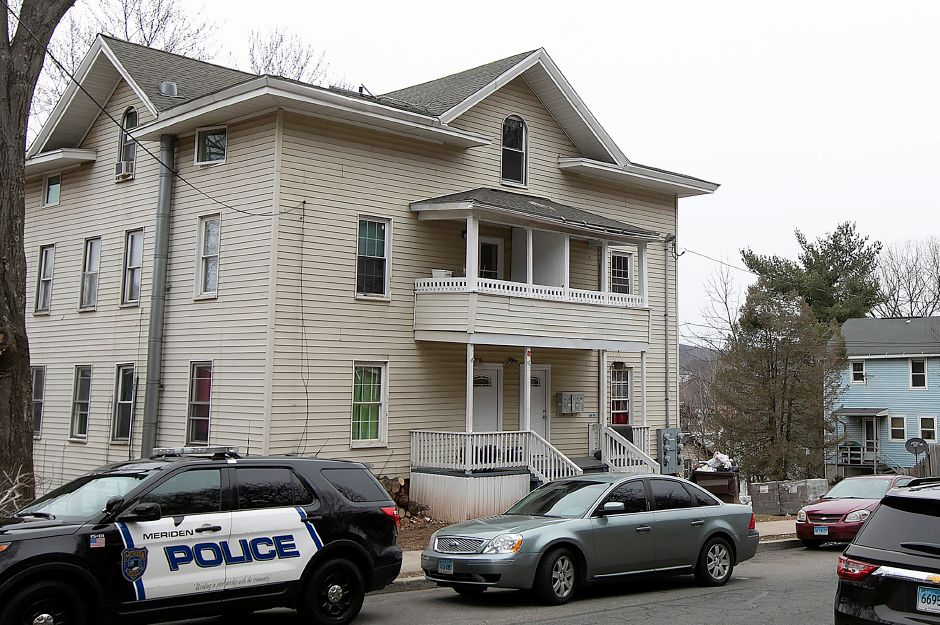 Meriden police investigate after an incident at 243 Crown St., Meriden, Thurs., Mar. 21, 2019. A city man faces charges after police said he assaulted a pregnant woman and was found with drugs and firearms. Dave Zajac, Record-Journal